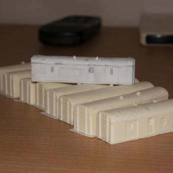 Completed styrene master of a CP / VVCP guards van atop an array of castings