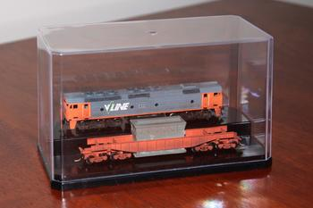 Two models on display inside the case