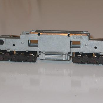 Kato manufactured SD7 underframe, with the top cut off so a cast bodyshell with fit
