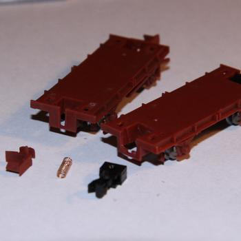 GY underframe before (left) and after modification for Microtrains couplers